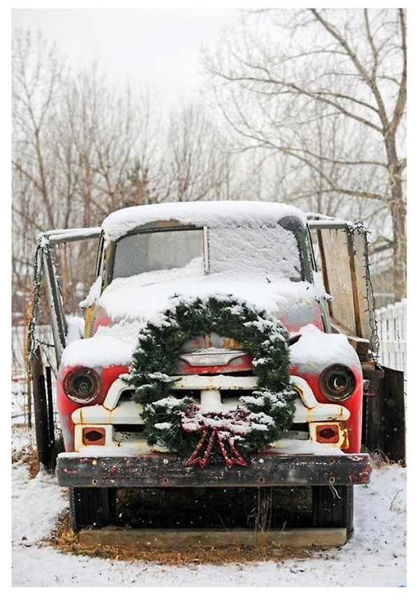snow-covered-old-red-truck-with-christmas-wreath-decorating-the-front-grill